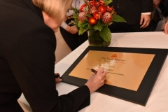Carol Giuseppi, CEO, Tourism Accommodation Australia, signing a plaque to commemorate the Official Opening of The Tank Stream Hotel